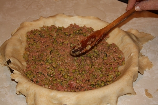 Adding meat to the Maltese Torta Recipe dough