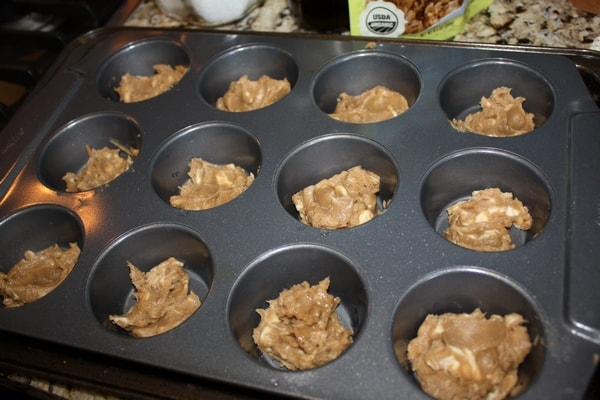 baking muffin tin filled with batter