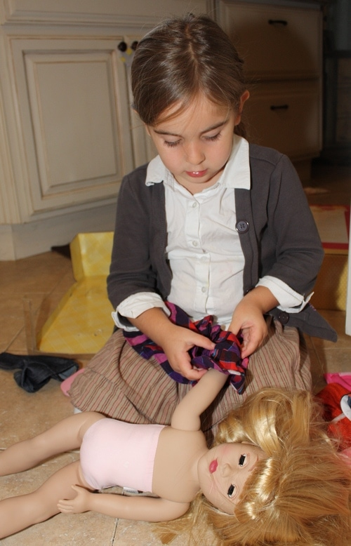 Child playing with Dollie and Me doll