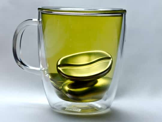 yellow glass with coffee bean inside