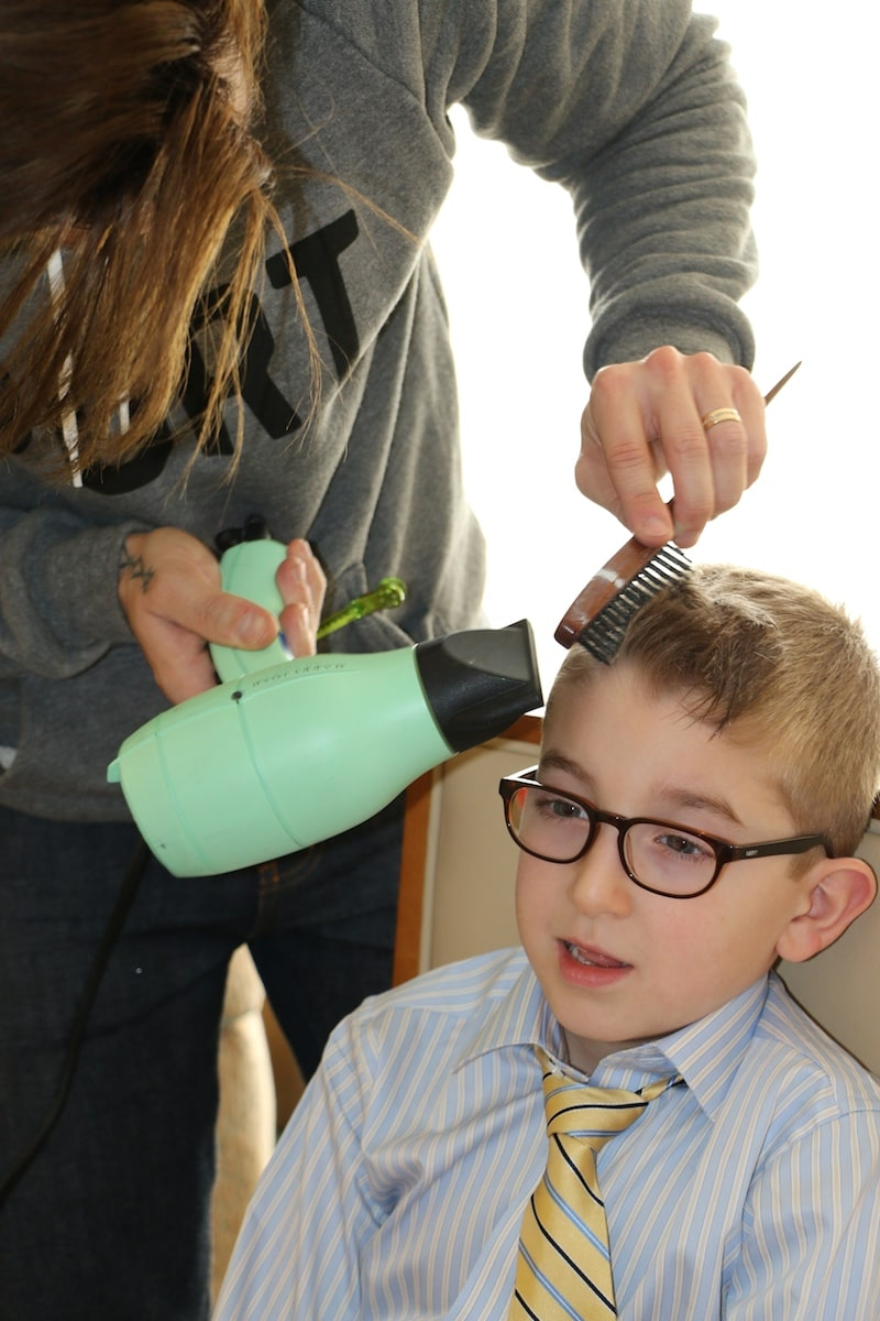 Suave Kids And Ryan Richman styling young boy's hair in LA