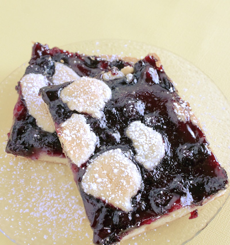 Blueberry Pie Bars on plate with powdered sugar