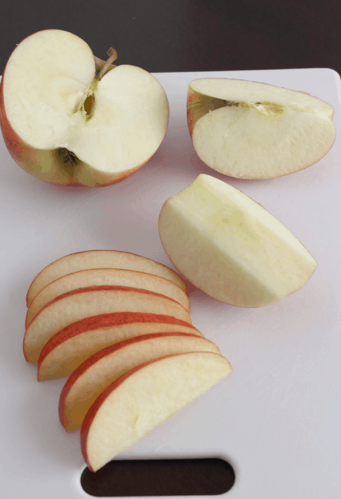 Sliced apples on cutting board