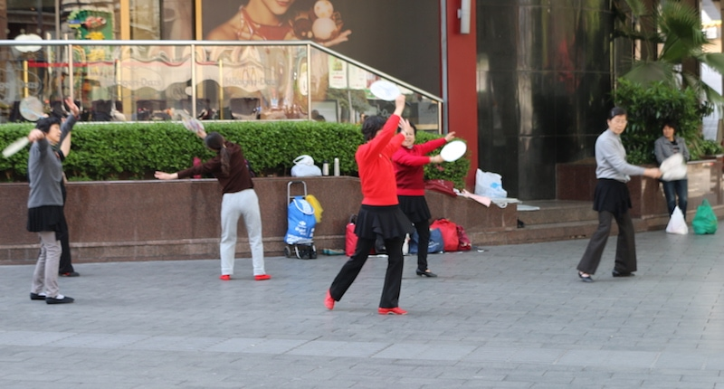 women dancing with fans in china