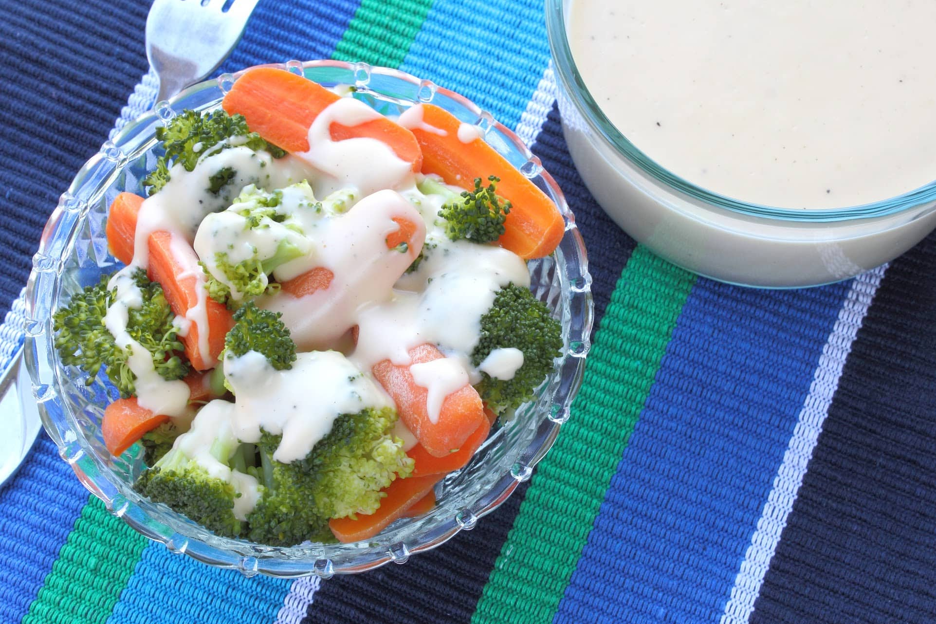 Steamed Broccoli And Baby Carrots With Creamy Cheese Sauce Recipe