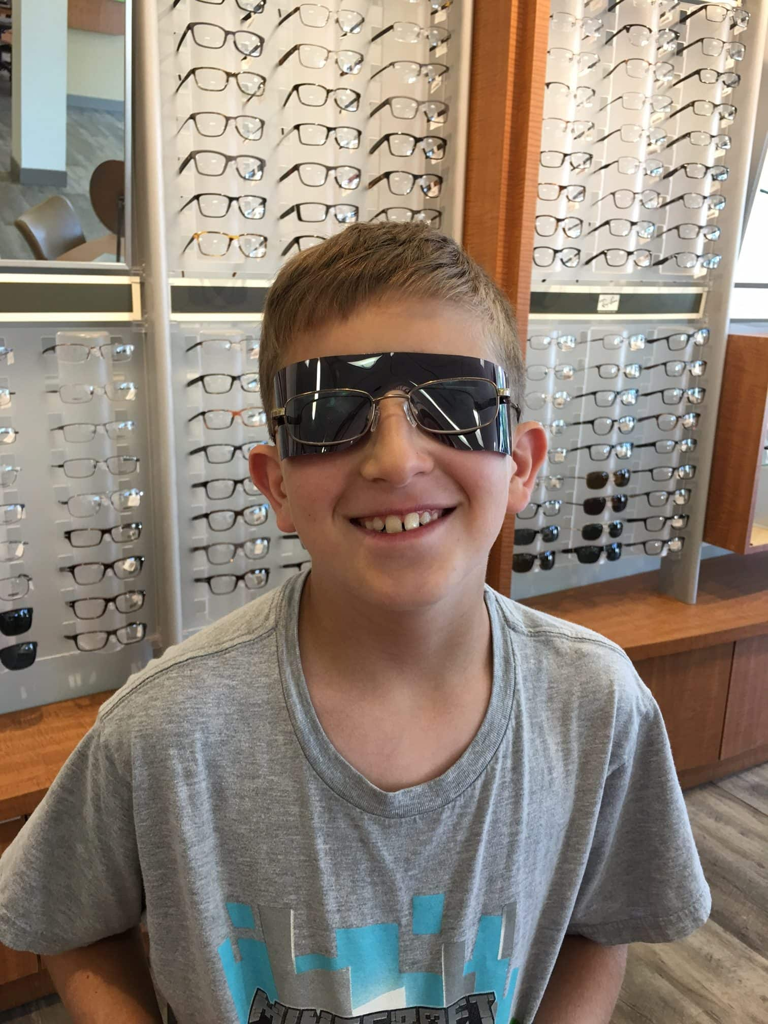 6acb4f58f4e Liam got to walk out of Pearle Vision with some funny new shades! Just  kidding! In order to check the back of his eyes