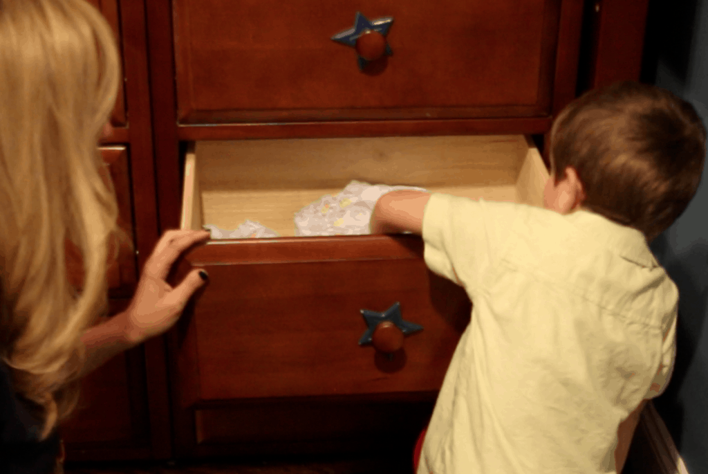 place Pampers Easy Ups Training Underwear in drawer