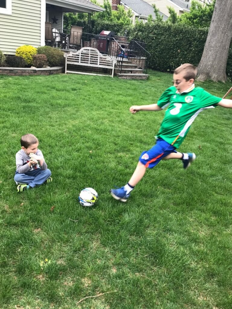kids playing soccer and being active outside