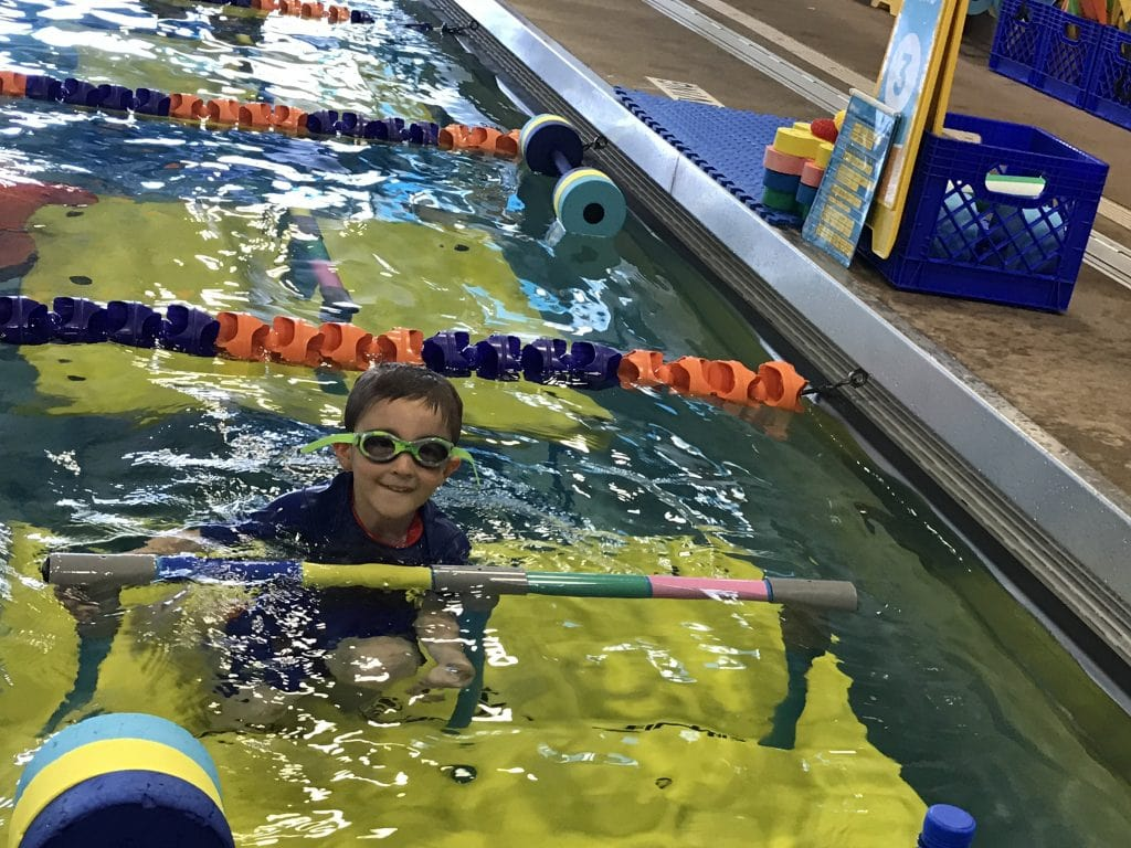 Having fun in the water at Goldfish swimming class