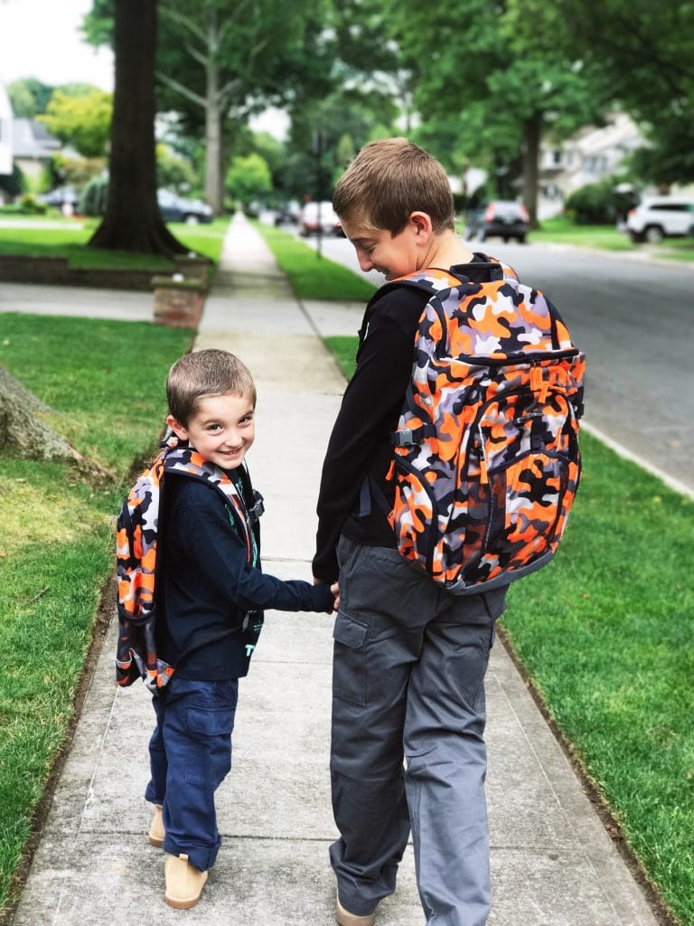 brothers heading to school together with lands end backpack