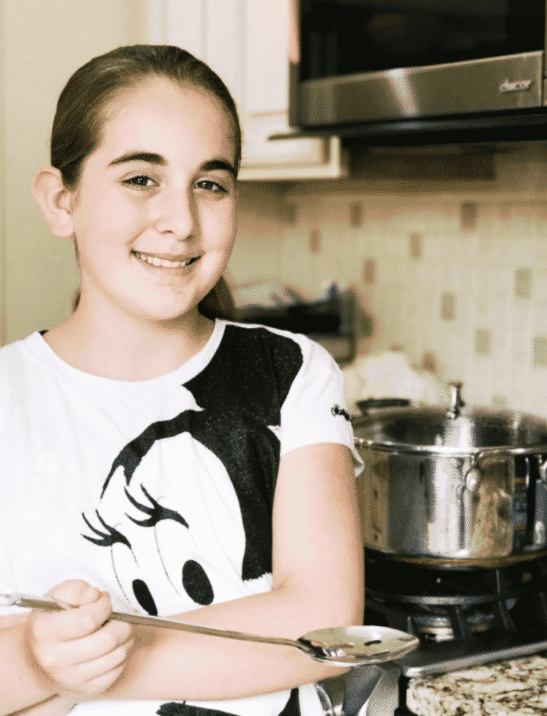 Teenager Cooking Dinner for Family