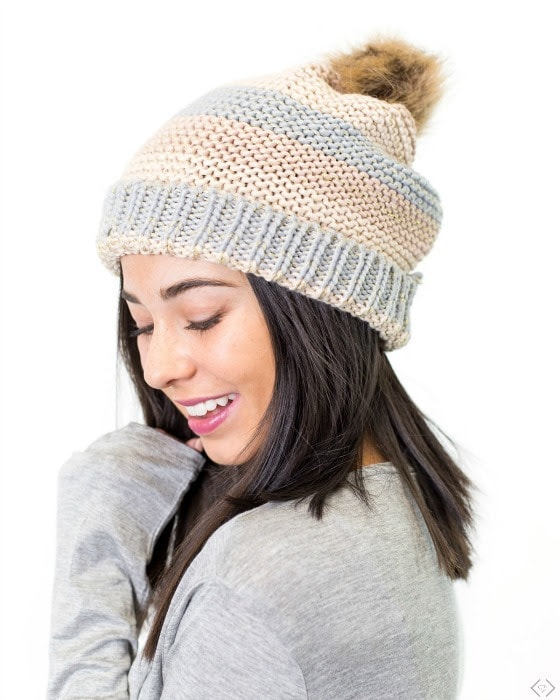 muted color pom pom hat
