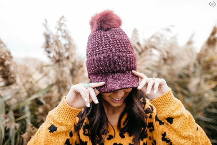 maroon hat with cap and pom pom