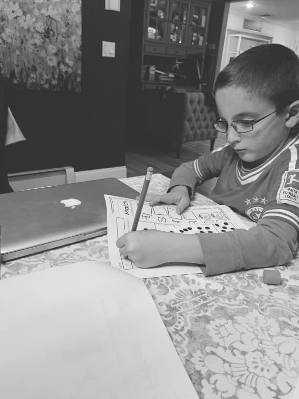 Boy Doing Homework In Kindergarten