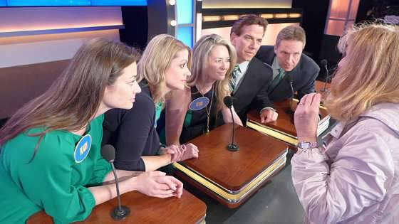 Family Feud family talking on set