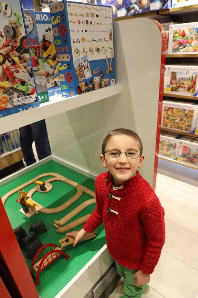 kid playing inside FAO Schwarz NYC
