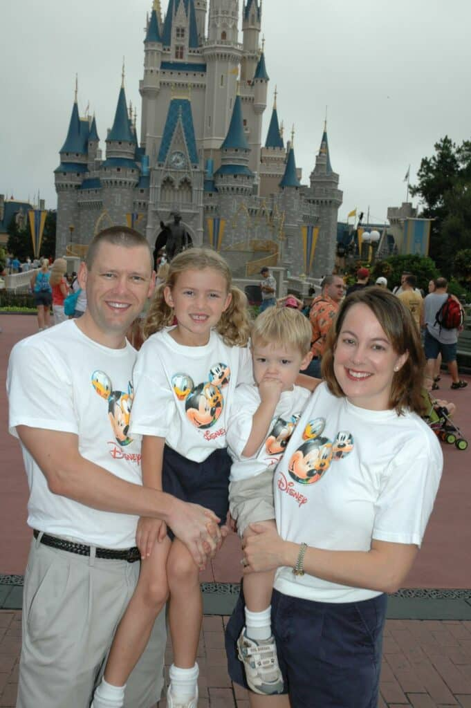 Family photo in front of Cinderella Castle Disney