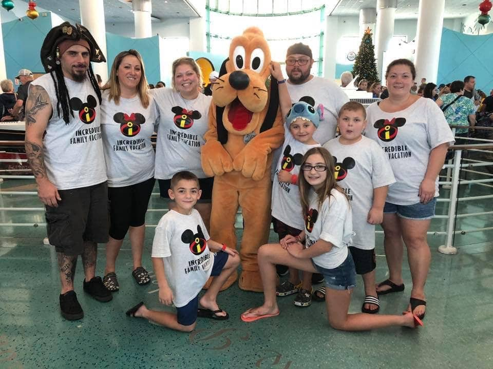 Family photo with Pluto Disney Cruise Matching Shirts