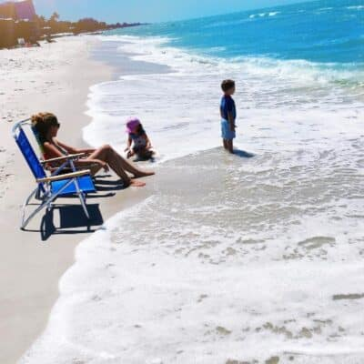 Mom at the beach with the kids