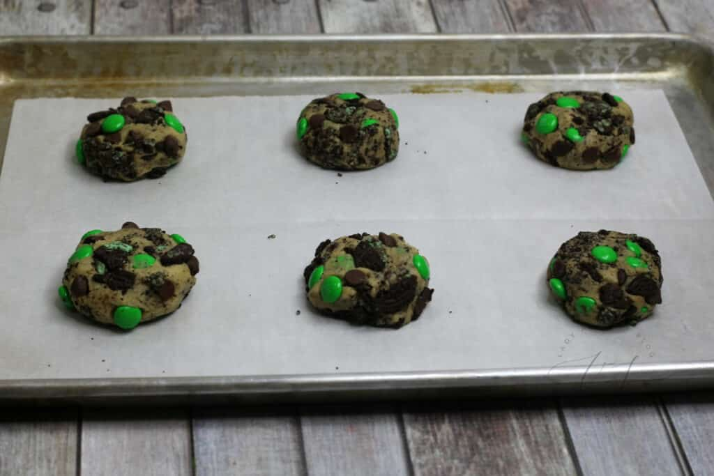 green and brown cookies on cookie sheet