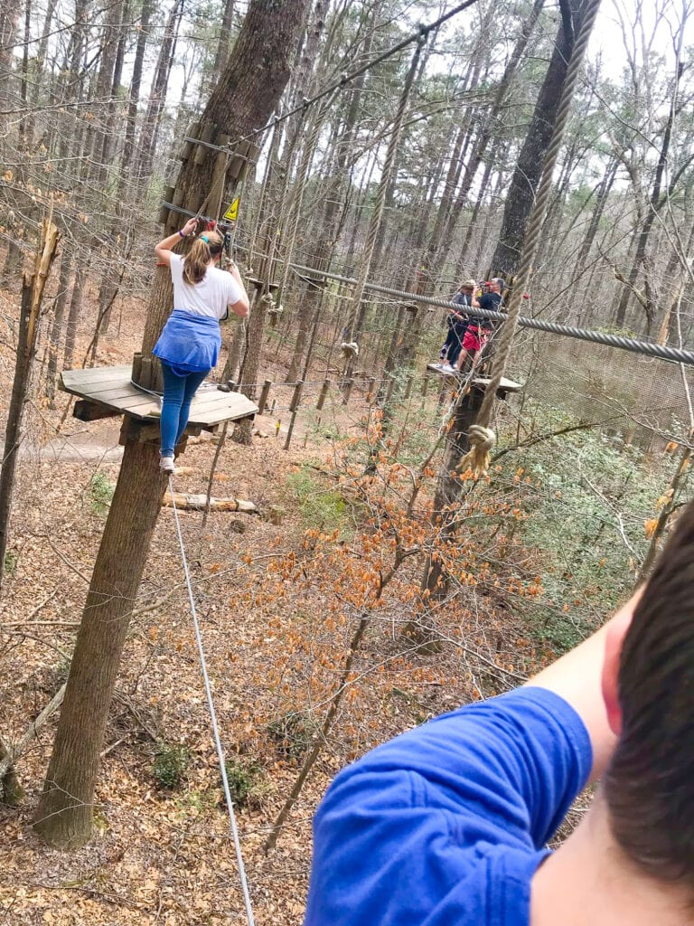 teens in trees doing obstacle course