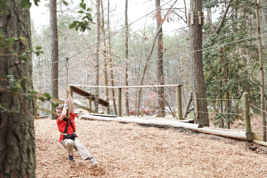 young boy zip lining in Virginia