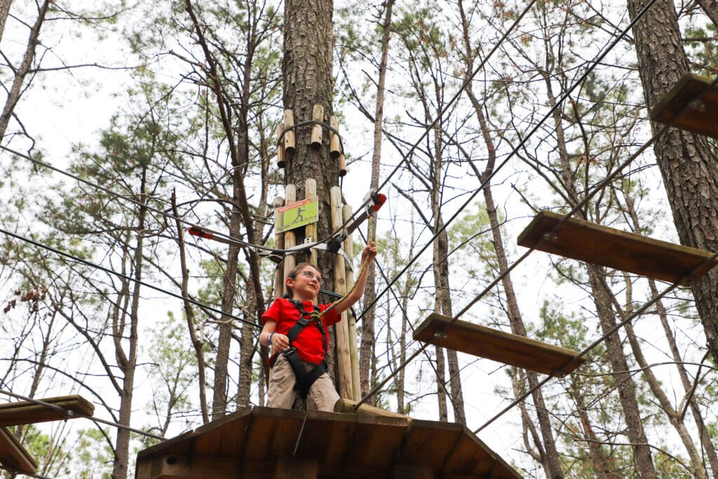 6 year old boy doing Go Ape obstacle course