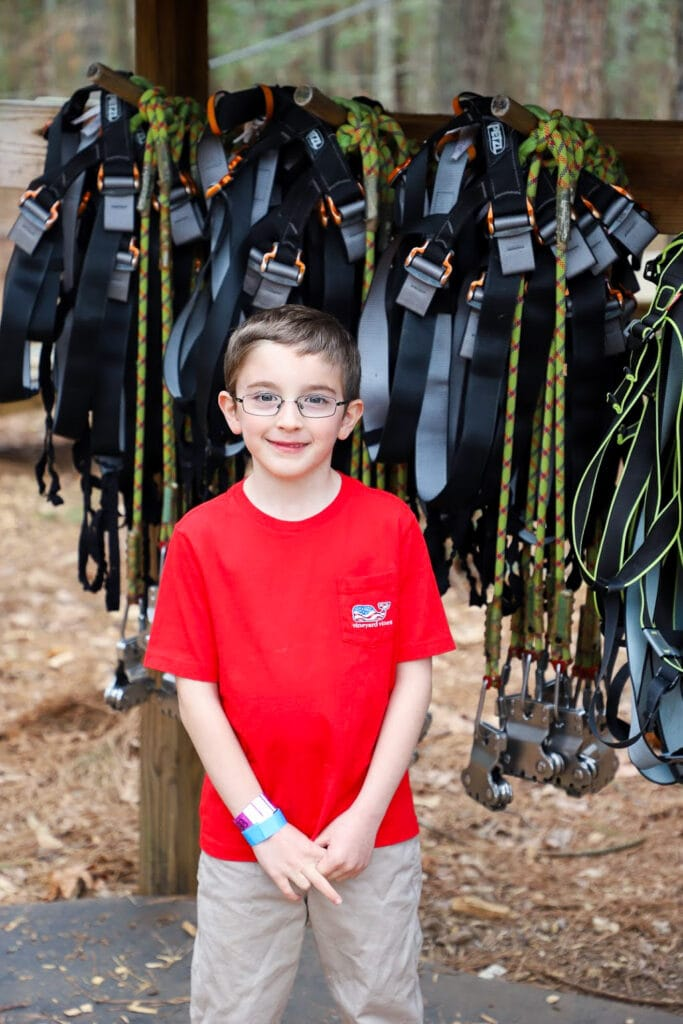 6 year old boy getting ready to zip line with Go Ape
