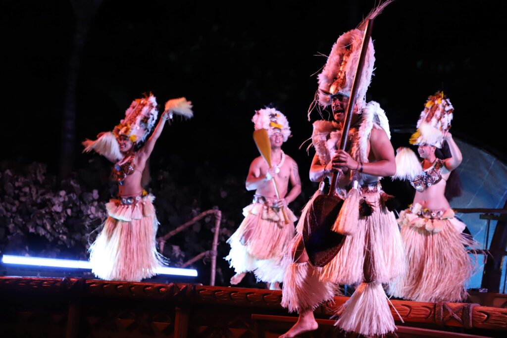 men dancing aulani luau