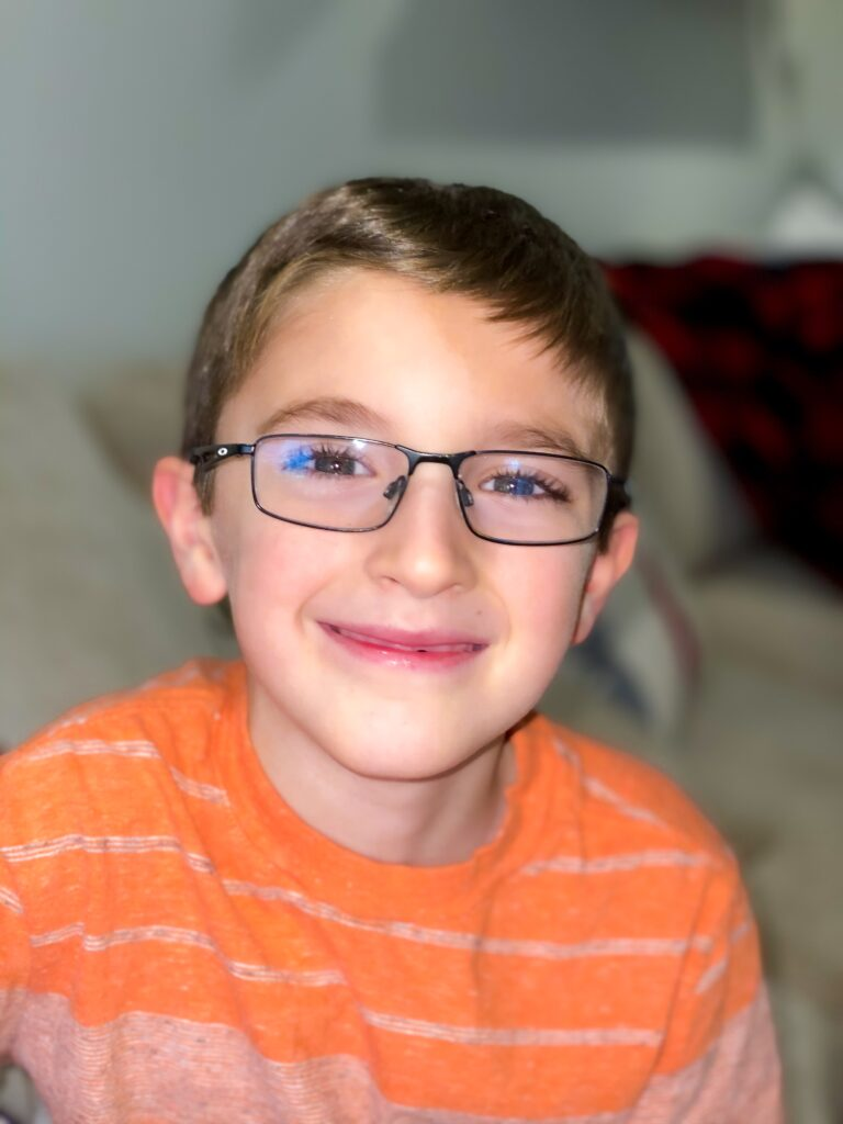 young boy in eyeglasses