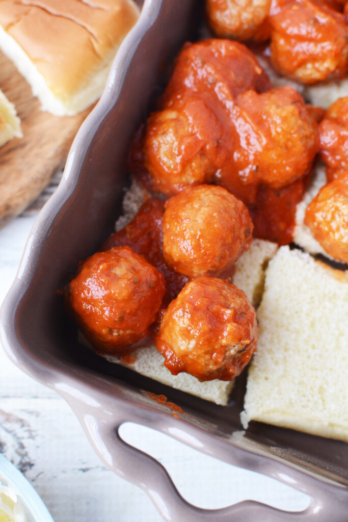 spoon meatballs on top of bread