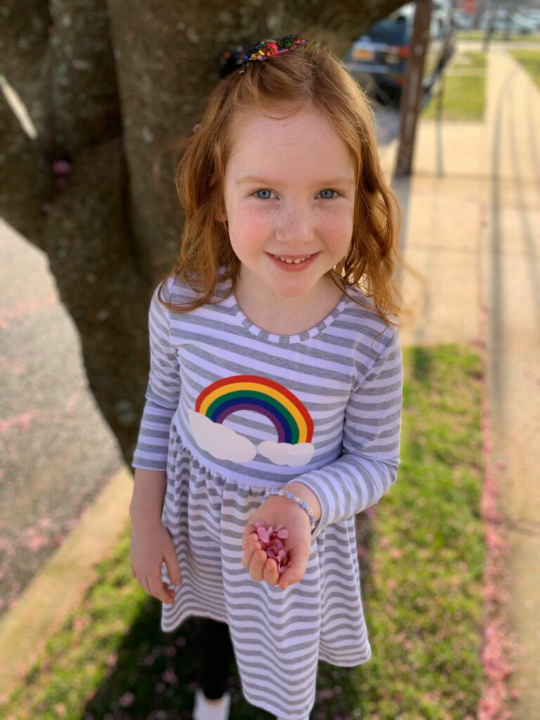 girl wearing a rainbow dress