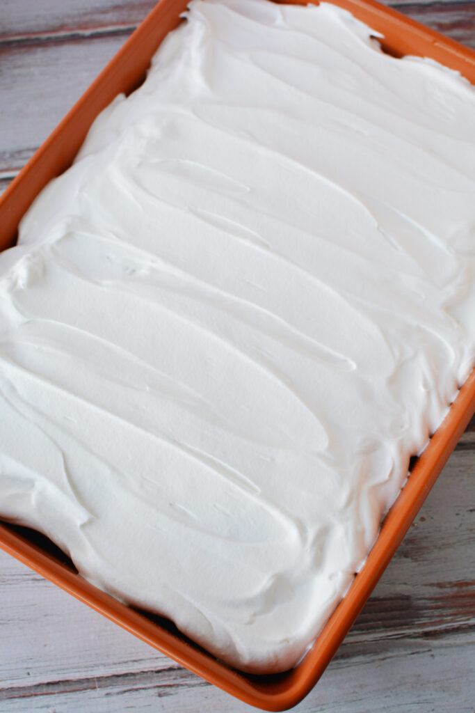 add whipped topping to cake